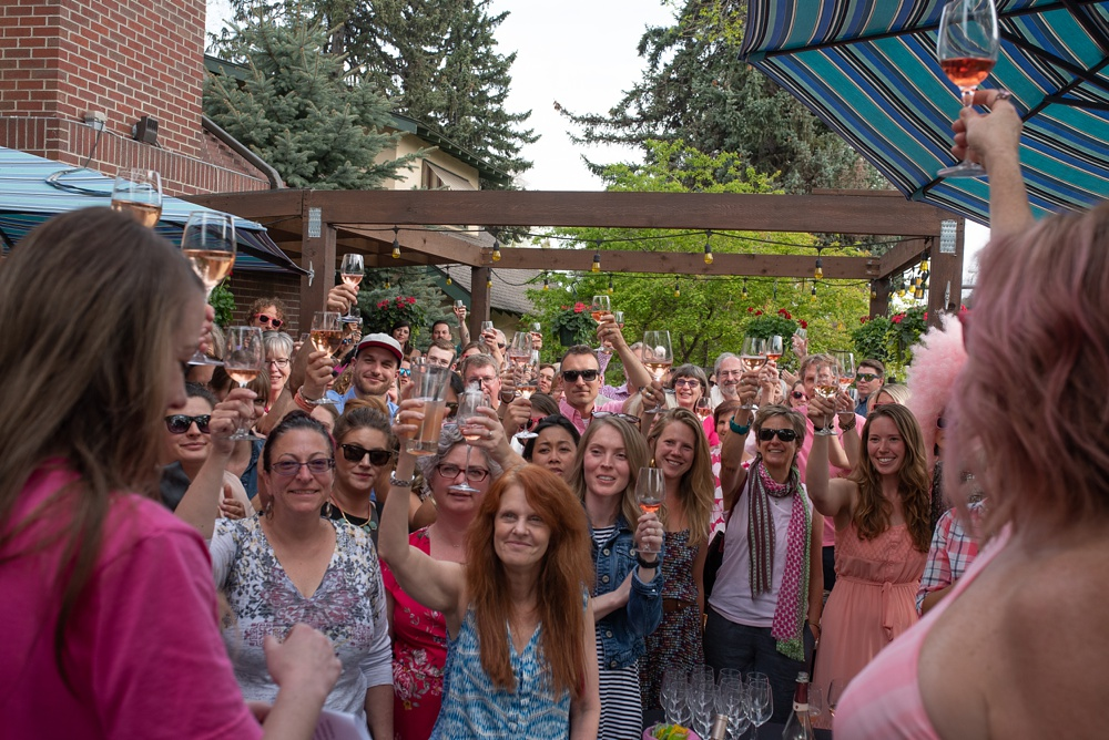 People cheers at the Pinked. event by Fortified Collaborations hosted by Cafe Vino in Fort Collins, Colorado. Event, food and beverage photography by Sonja Salzburg of Sonja K Photography.