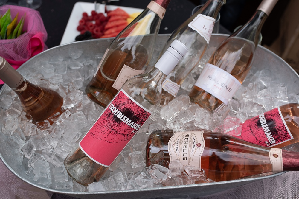Rose wine on ice ready for the Fortified Collaborations Pinked. event at Cafe Vino in Fort Collins, Colorado. Event photography by Sonja Salzburg of Sonja K Photography.