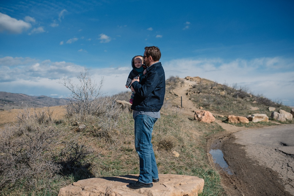 A father and his child at Horsetooth Reservoir outside of Fort Collins, Colorado. Family portrait photography by Sonja Salzburg of Sonja K Photography.