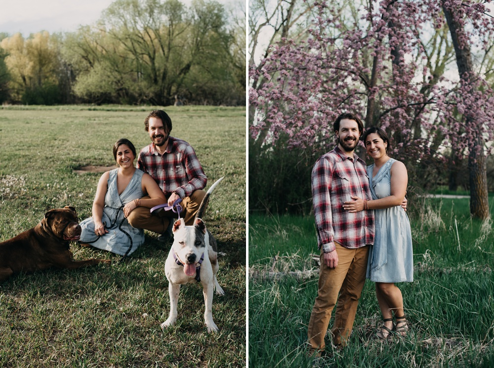 A happy engaged couple with their dogs at an engagement session in Fort Collins, Colorado. Engagement portrait photography by Sonja Salzburg of Sonja K Photography.