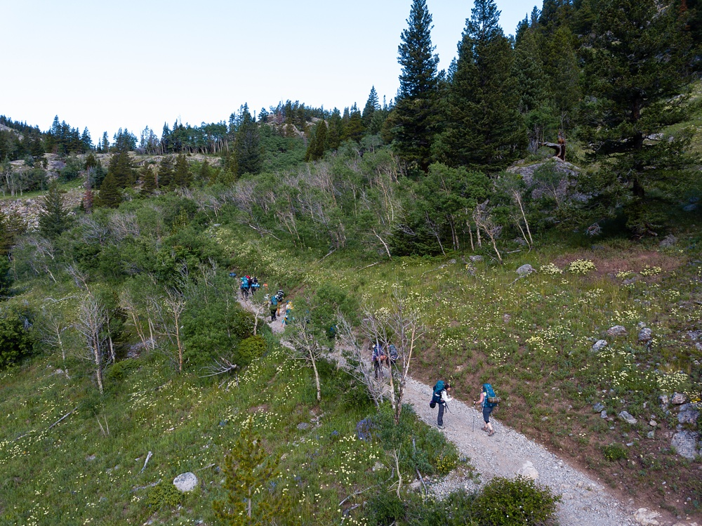 An arial photograph of backpackers on the Wellbody Woman Summer TRIBE Program in Indian Peaks Wilderness in Colorado. Outdoor event photography by Sonja Salzburg of Sonja K Photography.