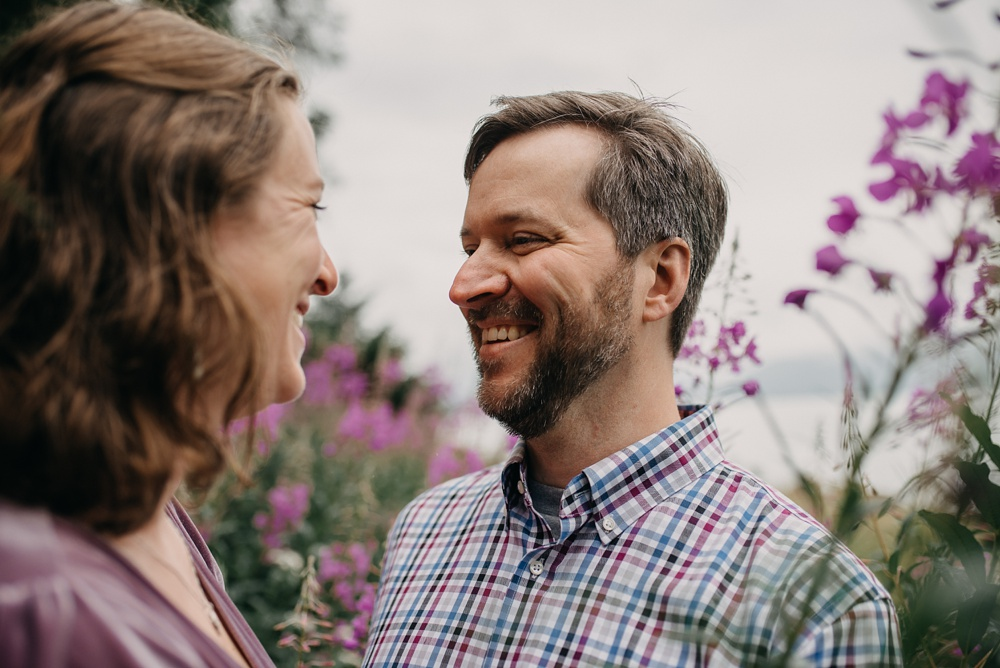 A newly engaged couple at the Jensen-Olson Arboretum outside of Juneau, Alaska. Engagement portrait photography by Sonja Salzburg of Sonja K Photography.