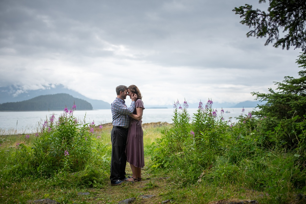 A young engaged couple at the Jensen-Olson Arboretum outside of Juneau, Alaska. Engagement portrait photography by Sonja Salzburg of Sonja K Photography.