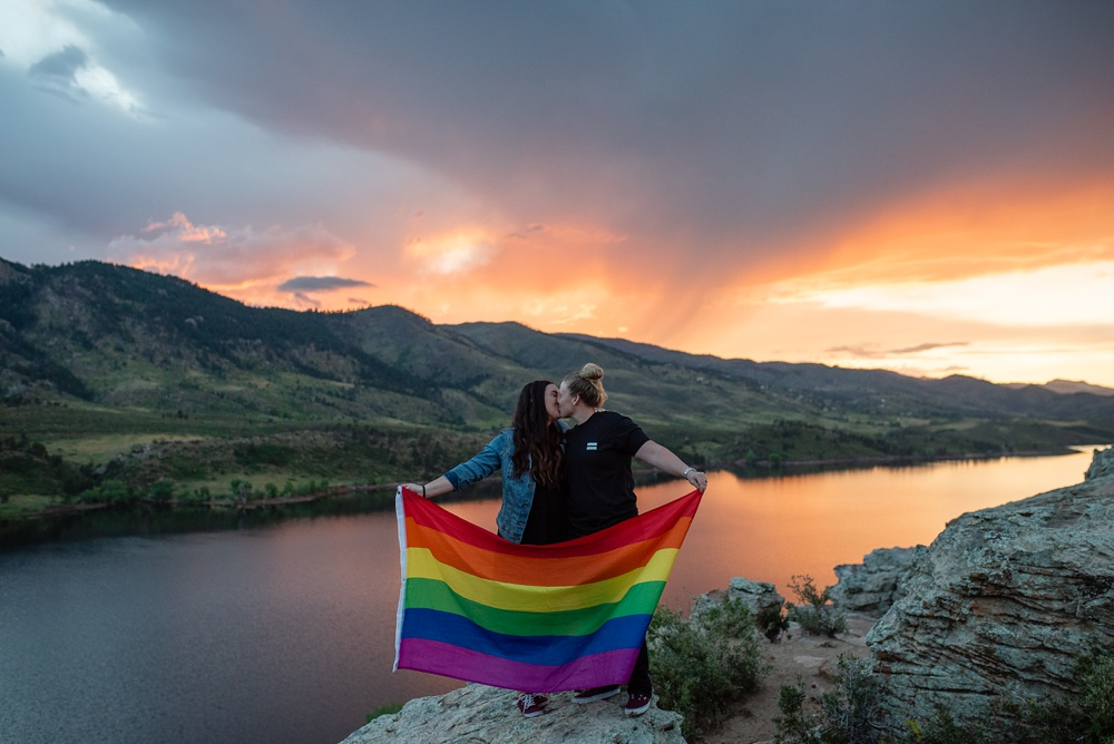 A proud couple at Duncan Ridge outside of Fort Collins, Colorado. Maternity portrait photography by Sonja Salzburg of Sonja K Photography.