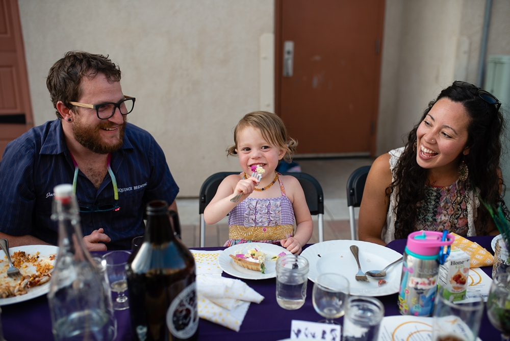 A young family enjoys dessert by Fish Restaurant at the Fortified Collaborations Send Sunday Supper in Montezuma Fuller Alley in Fort Collins, Colorado. Event and Food and Beverage Photography by Sonja Salzburg of Sonja K Photography,