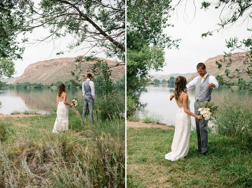 A bride and groom do their first look on the banks of Watson Lake outside of Laporte, Colorado. Wedding photography by Sonja Salzburg of Sonja K Photography.