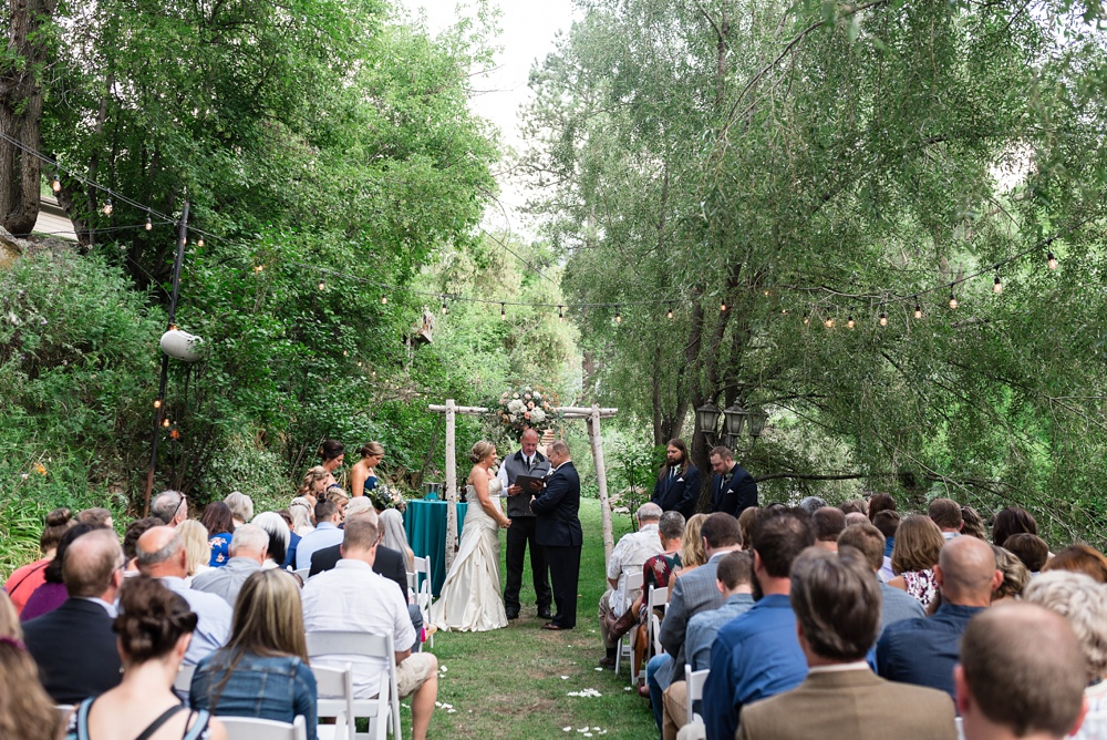 A wedding ceremony at Wedgewood Weddings on Boulder Creek. Wedding photography by Sonja Salzburg of Sonja K Photography.