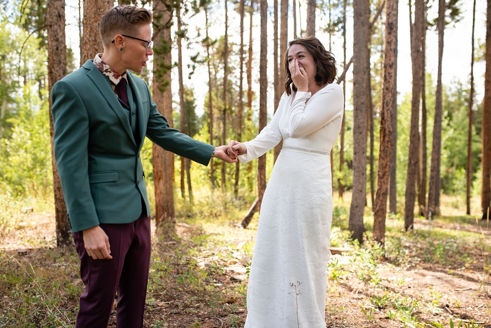 A first look at a gay wedding in Fraser, Colorado. Lesbian wedding photography by Sonja Salzburg of Sonja K Photography.