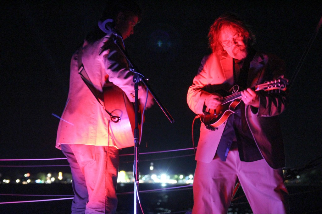 Billy Strings and Don Julin on the Nauticat sailboat in Grand Traverse Bay