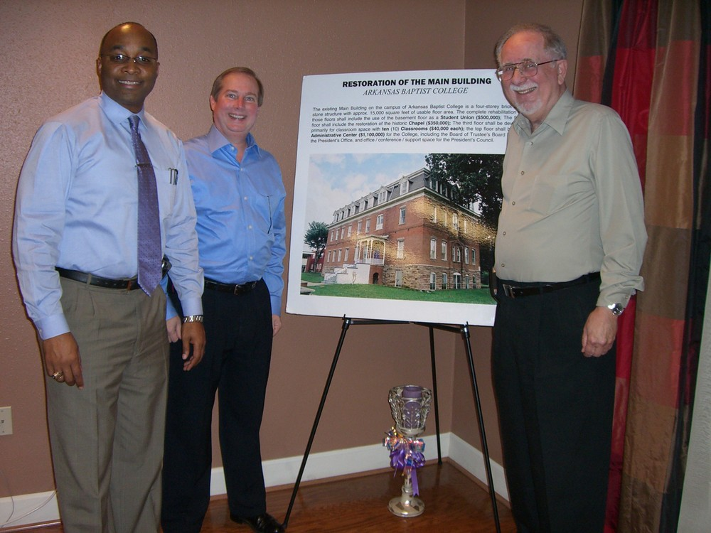 Pictured from left are Dr. Fitz Hill, president of Arkansas Baptist College, Dr. Ray Higgins, CBF Arkansas Coordinator and Charles Ray, retired CBF Arkansas Special Projects Coordinator. Also pictured is a projection of the completed restoration to the Old Main building on the ABC campus.