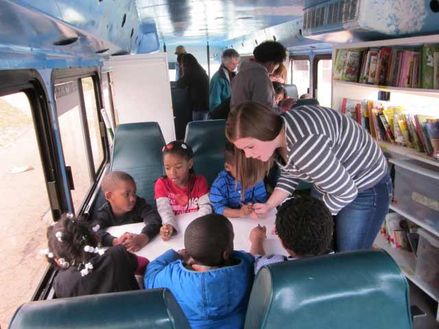 Inside the Stories on Wheels bus, a part of Together for Hope's campaign for childhood literacy
