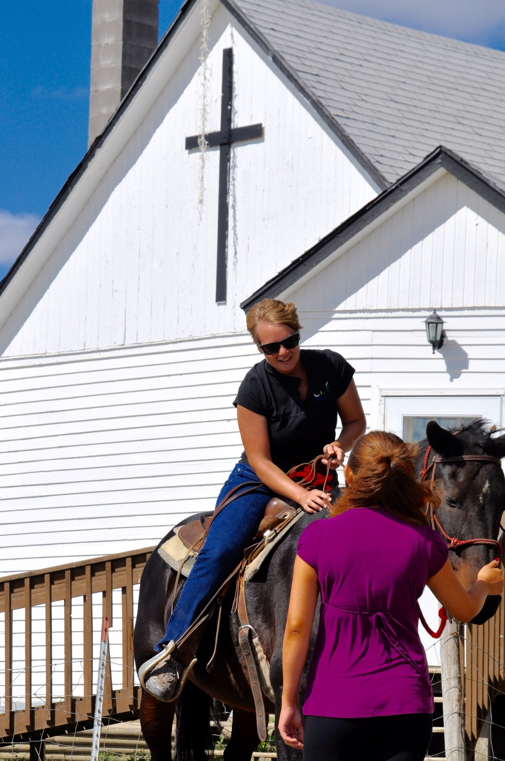 Megan Pike, CBFAR Assistant Coordinator, learning from Tameka, a 17 year old who works with the horses, how to ride Brownie, one of  several horses in the ministry.  photo courtesy of Stephen Reeves
