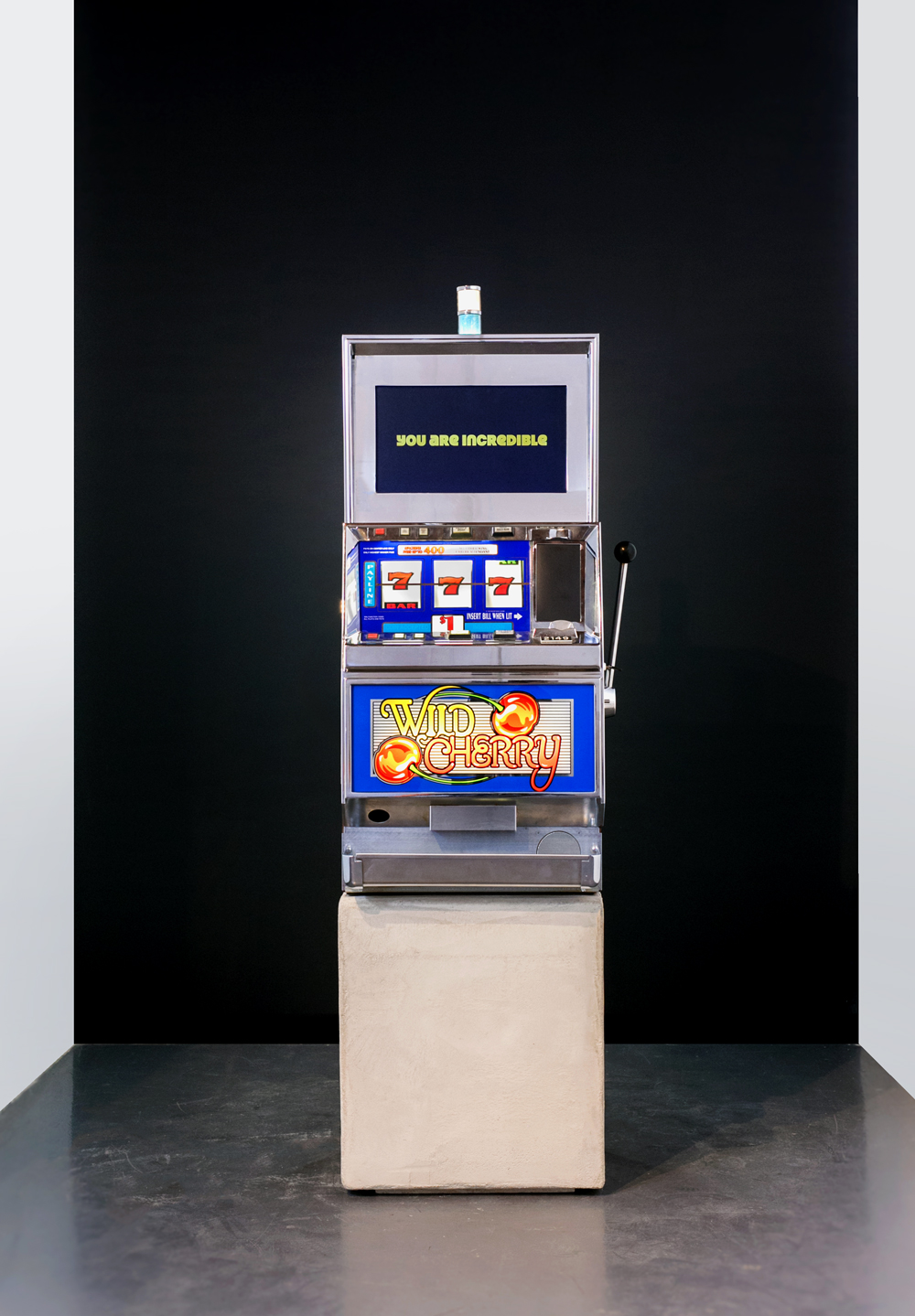 You Are A Winner, 2015, Wild Cherry slot machine with aluminum and 1:31 single channel video on concrete base, 46 x 21 x 20 inches (117 x 53 x 51 cm), unique