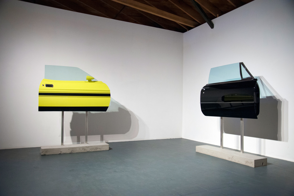 Fully Loaded, 2015, (left) 1971 Ford Mustang Mach 1 door, glass, aluminum and concrete, 42 x 48 x 8 inches, unique Made Man, 2015, (right) 1968 Cadillac Coupe Deville door, glass, aluminum, and concrete, 42 x 53 x 9 inches, unique