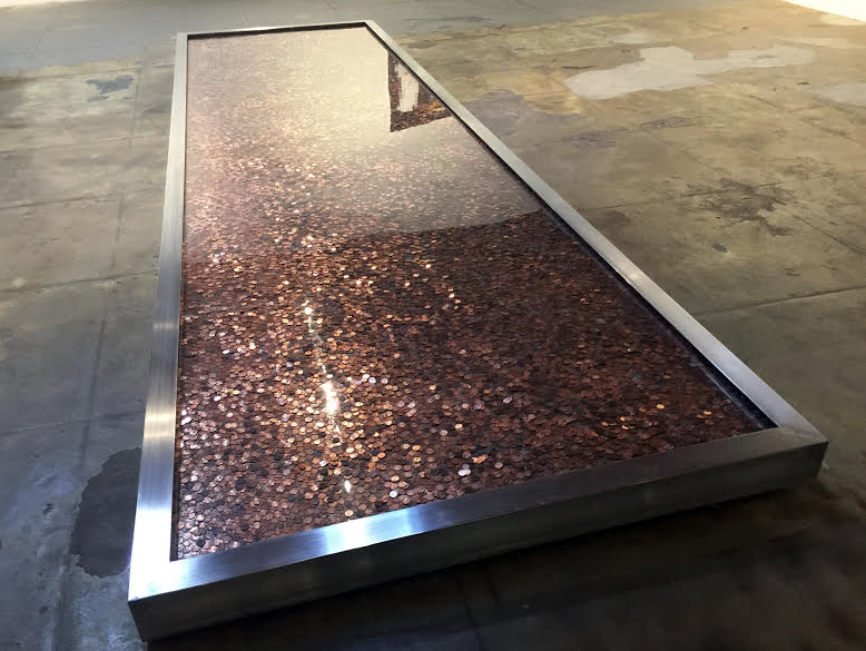 Mark Zuckerberg's Wealth in Pennies, 2015, 52,000 pennies, steel, aluminum, neon, and water, 214 x 62 x 5 inches (544 x 158 x 13 cm), unique