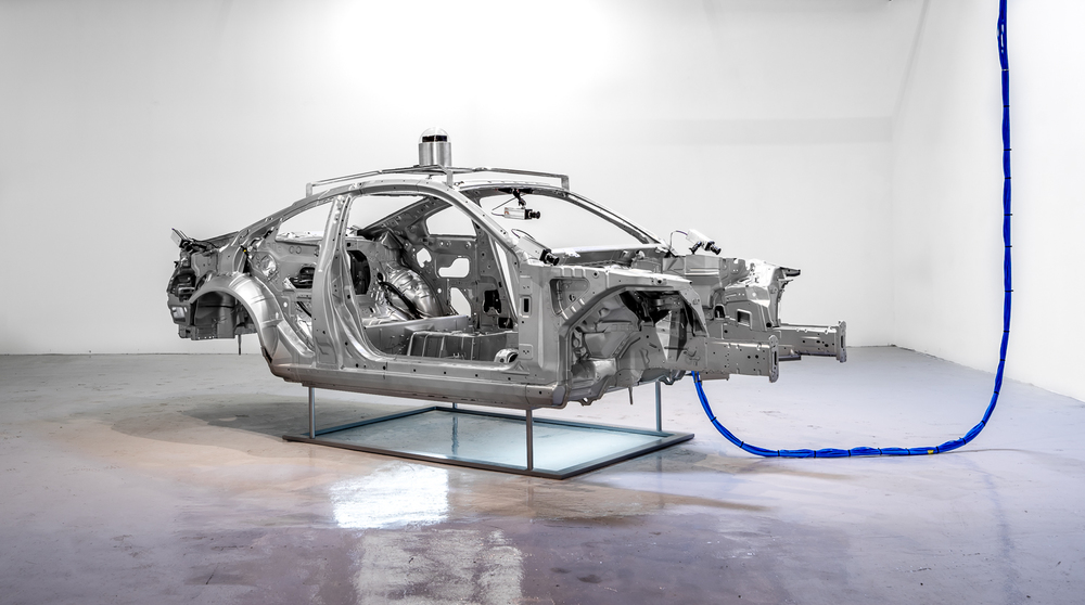 Autonomous X12, 2016  Sheet metal, aluminum, glass, rubber, steel, plastic, aerospace composites, powder coating and electronic components with 60:00 minute single channel video  75 x 164 x 71.5 in  (190.5 x 416.56 x 181.61 cm)
