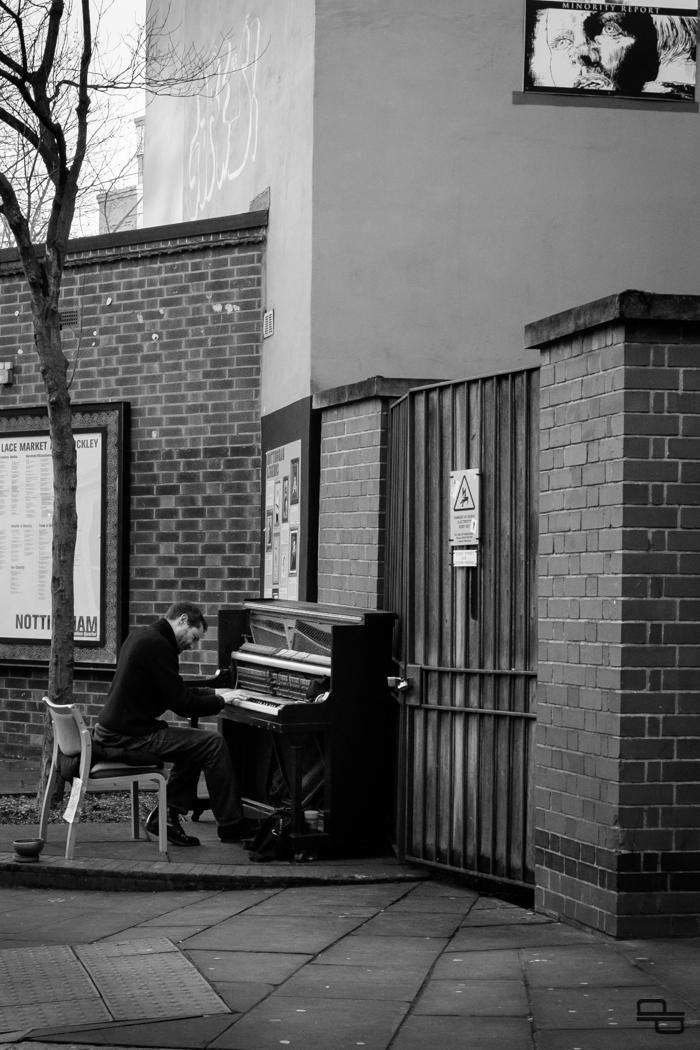 Black and white street pianist in Nottingham.
