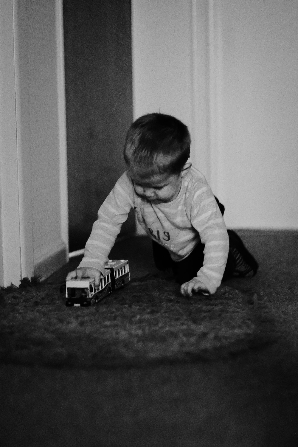 Ethan pushing toy bus