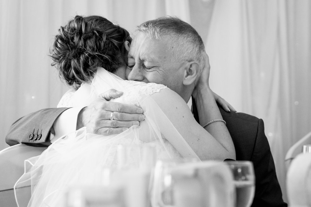 Father and daughter embrace on her wedding day. Nottingham