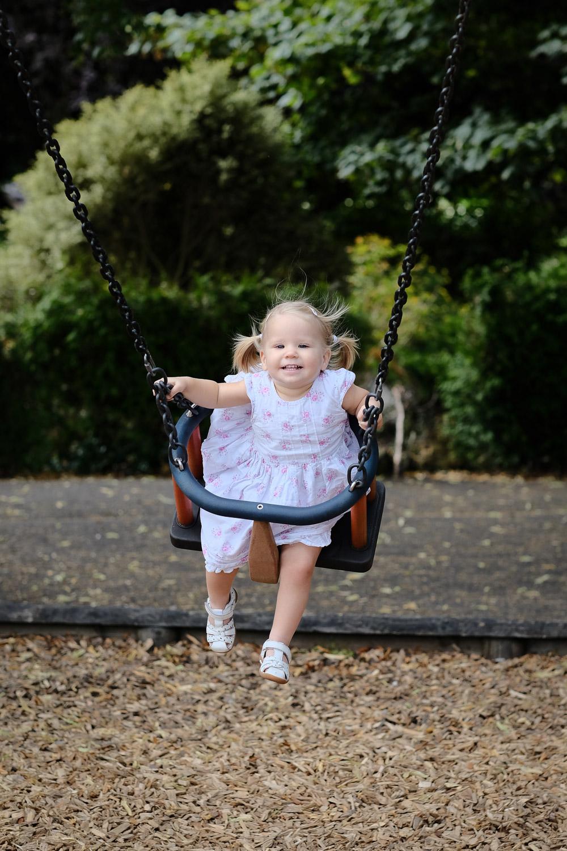 18_month_old_girl_enjoying_swing