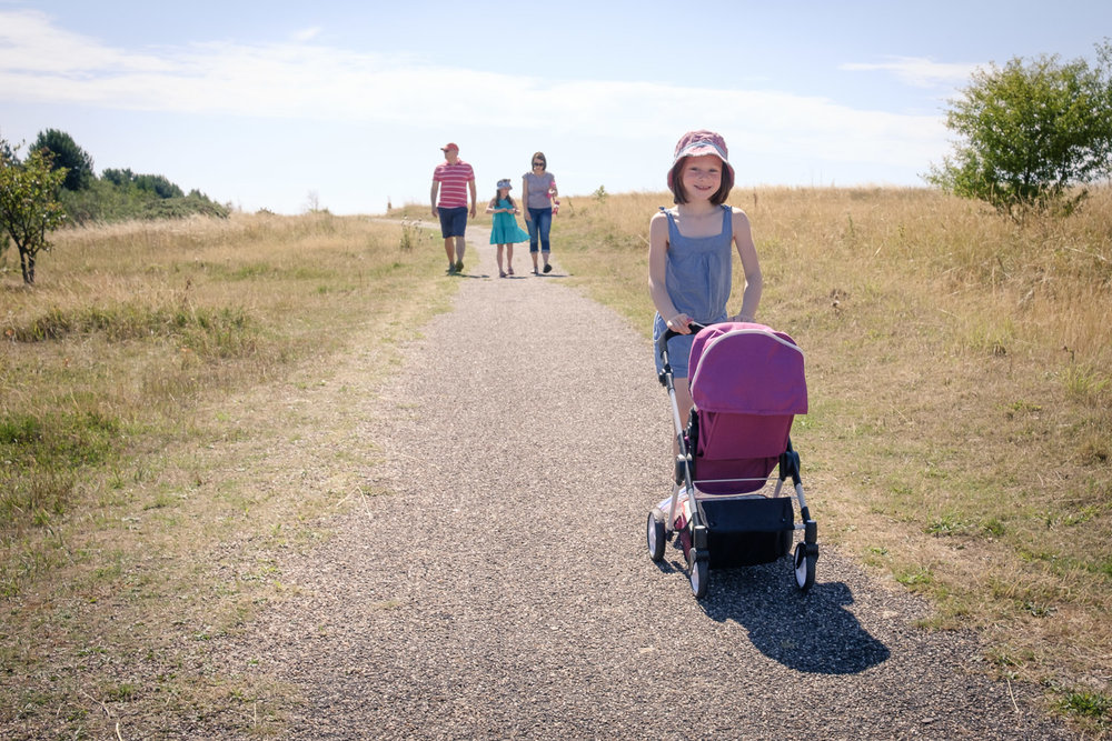 Documentary family photoshoot in Hucknall, Nottingham. Walking in The Ranges with family of 4, 2 girls with mum and dad.