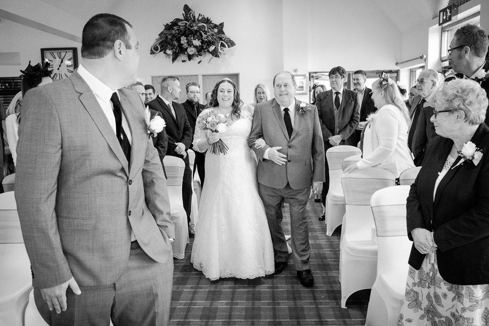 walking-down-the-isle-nottingham-wedding-photographer.jpg