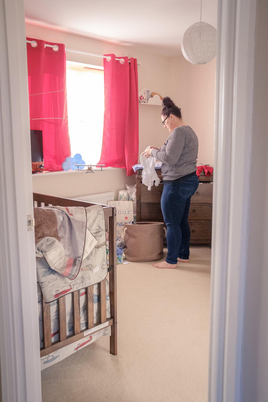 mum-putting-baby-washing-away