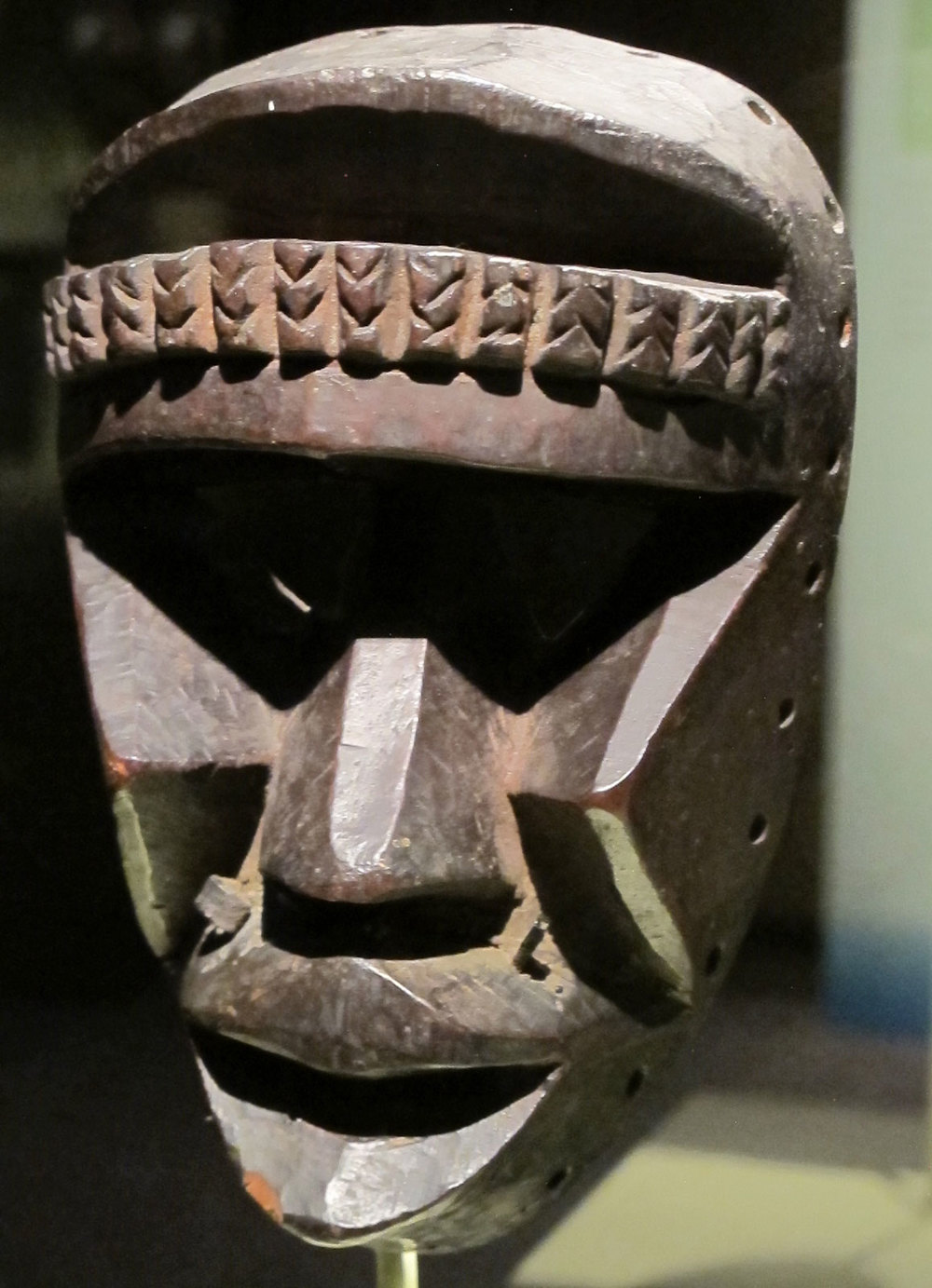 Kagle mask by Dan artist, Liberia, of wood and metal, mid 20th century.