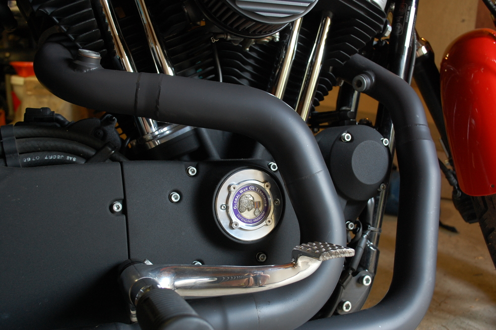 Military Challenge Coin mounted on a Harley Davidson Sportster