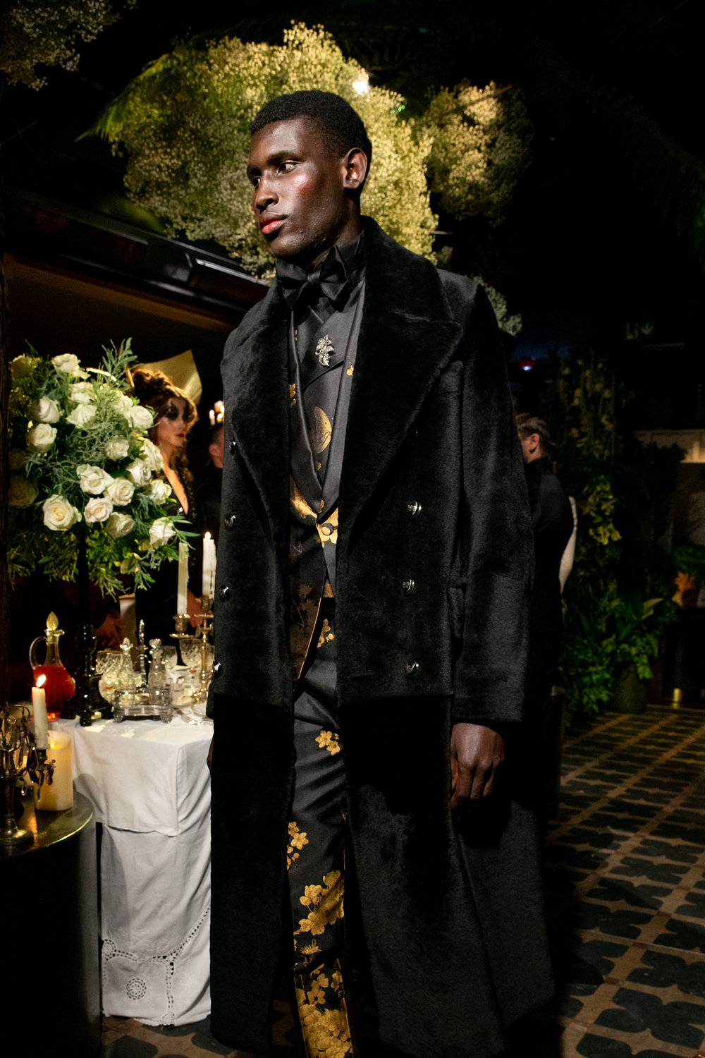 - FEATURED IN THIS LOOK£6200COATTHE GRAND COAT, BLACK SHEARLINGAVAILABLE THROUGH MADE-TO-ORDER£24202 PIECE SUITTHE EDWARD, BLACK & GOLD FALLING BLOSSOM SILK JAQUARDAVAILABLE THROUGH MADE-TO-ORDER£675WAISTCOAT THE BEAU, BLACK & GOLD FALLING BLOSSOM SILK JAQUARDAVAILABLE THROUGH MADE-TO-ORDER £450SHIRT THE WALTER WING TIP COLLAR DRESS SHIRT, BLACK COTTONAVAILABLE THROUGH MADE-TO-ORDER£120ACCESSORIEWIDE BOWTIE, BLACK SILKAVAILABLE THROUGH READY-TO-WEARACCESSORIEBROOCH, SILVER WITH DIAMOND GEMSTONESAVAILABLE THROUGH MADE-TO-ORDER£710BOOTSTHE LOUIS, BLACK PATENT WITH GOLD METAL TRIMAVAILABLE THROUGH MADE-TO-ORDER__________________________BOOK A MADE-TO-ORDER APPOINTMENT