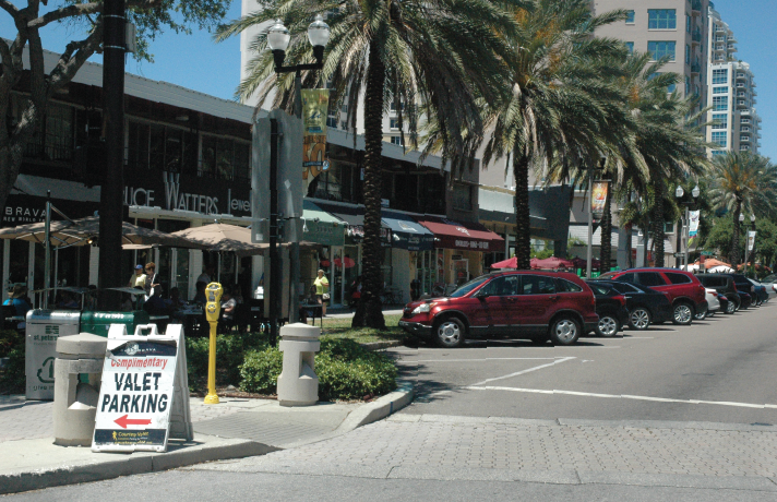 "Sign offers ""Complimentary Valet Parking."" St. Petersburg, Florida."