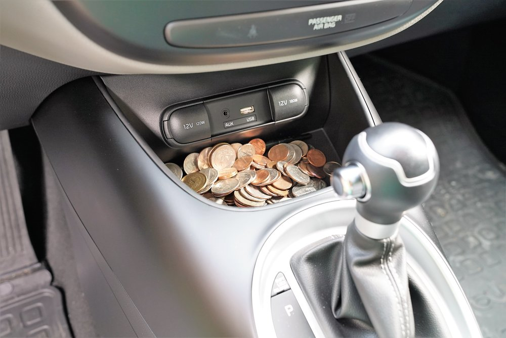 Coins are going to go missing when valet parking a car. (They might all disappear!) If you don't want to lose your change or any other items of value, then remove them from your car before handing over your keys to the valet.