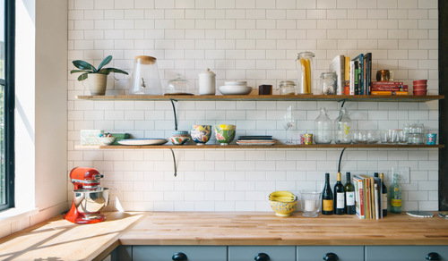 Open Shelves With Subway Tile And Butcher Block