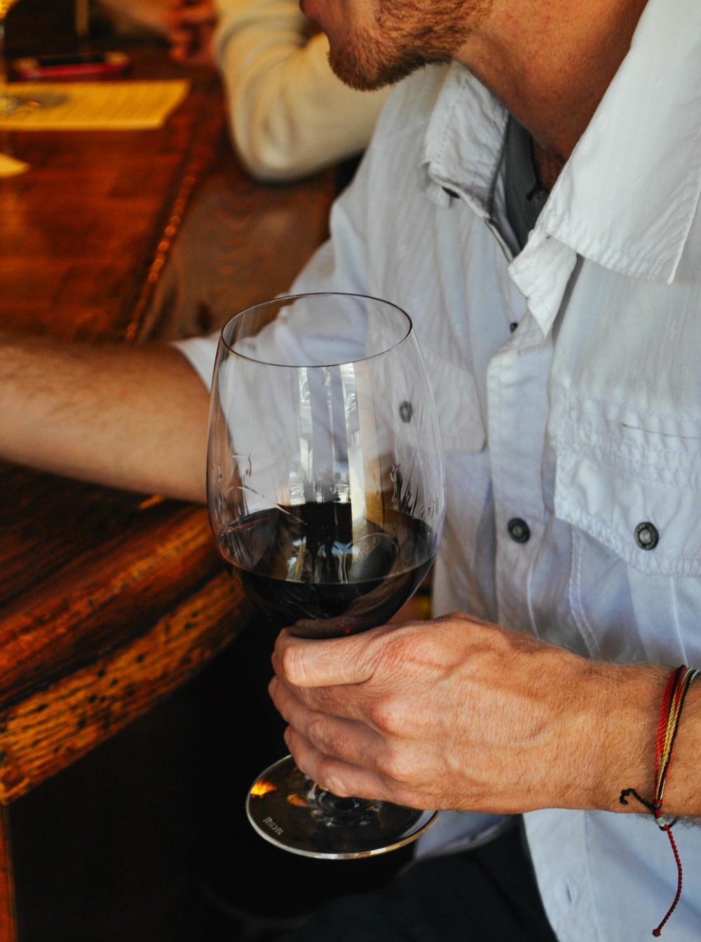 Man with glass of cab.jpg