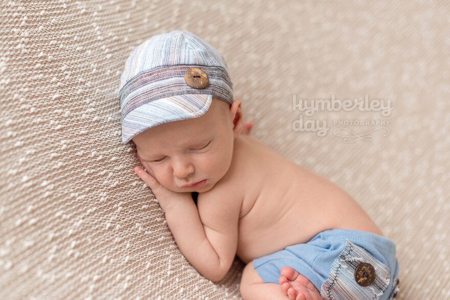 Orange County newborn photographer | baby with blue baseball cap