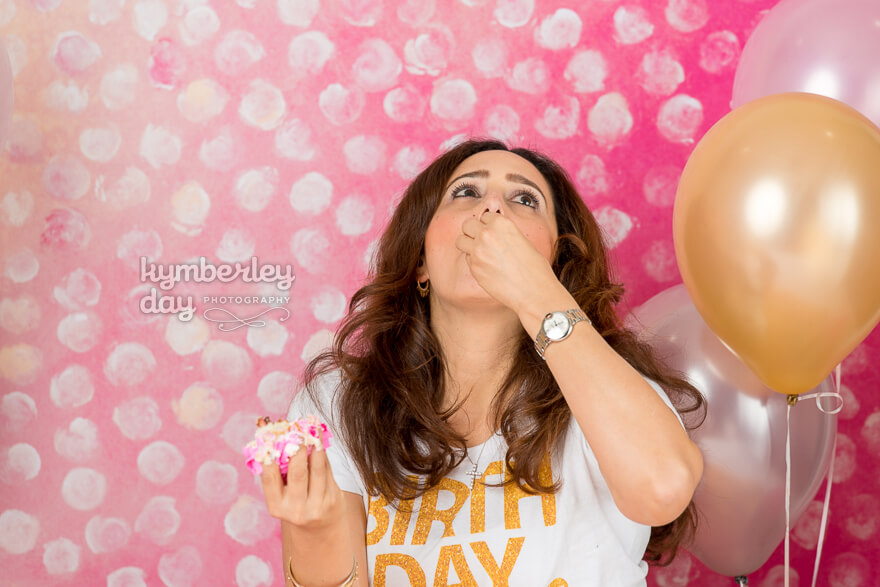 woman eating cake photoshoot balloons