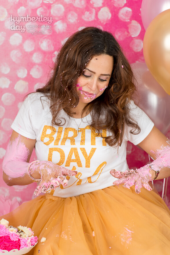 covered in frosting cake smash birthday photo