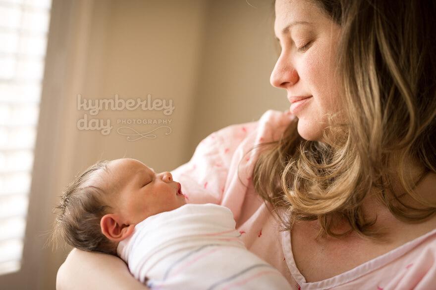 orange county newborn photographer captures mom and baby