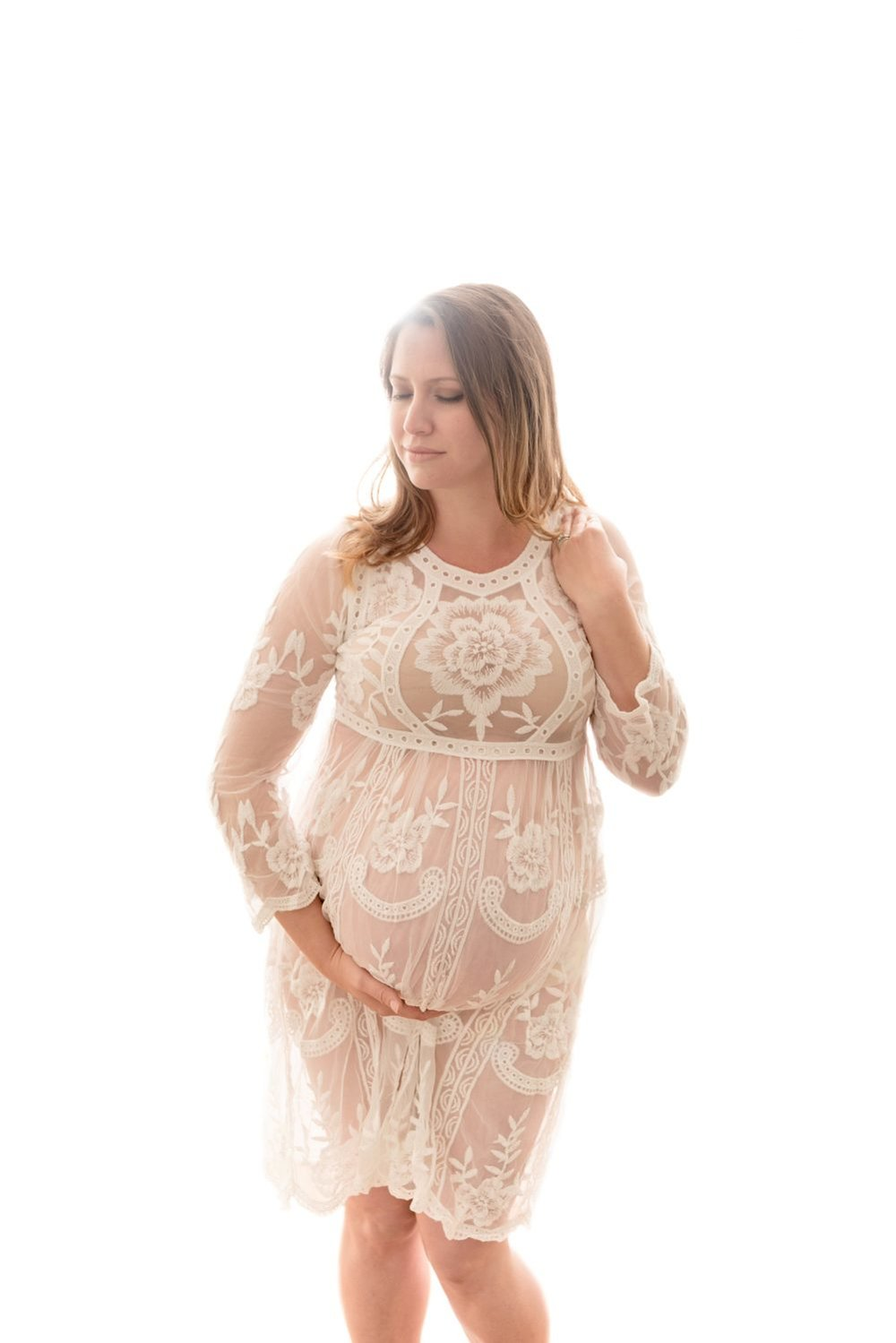 studio backlighting lace white dress pregnant belly