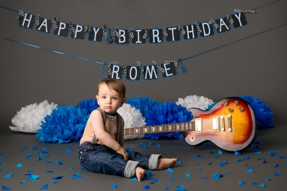 punk rock birthday baby with electric guitar