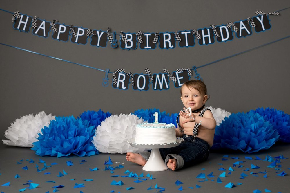 cake smash photo birthday grey white blue