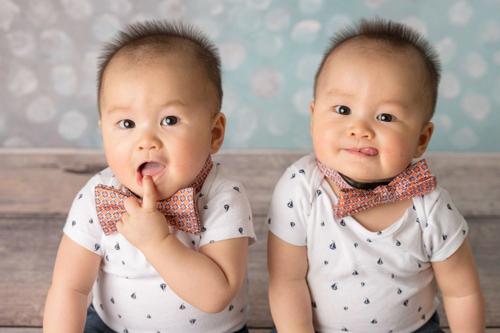 asian twin boys wearing bow ties closeup
