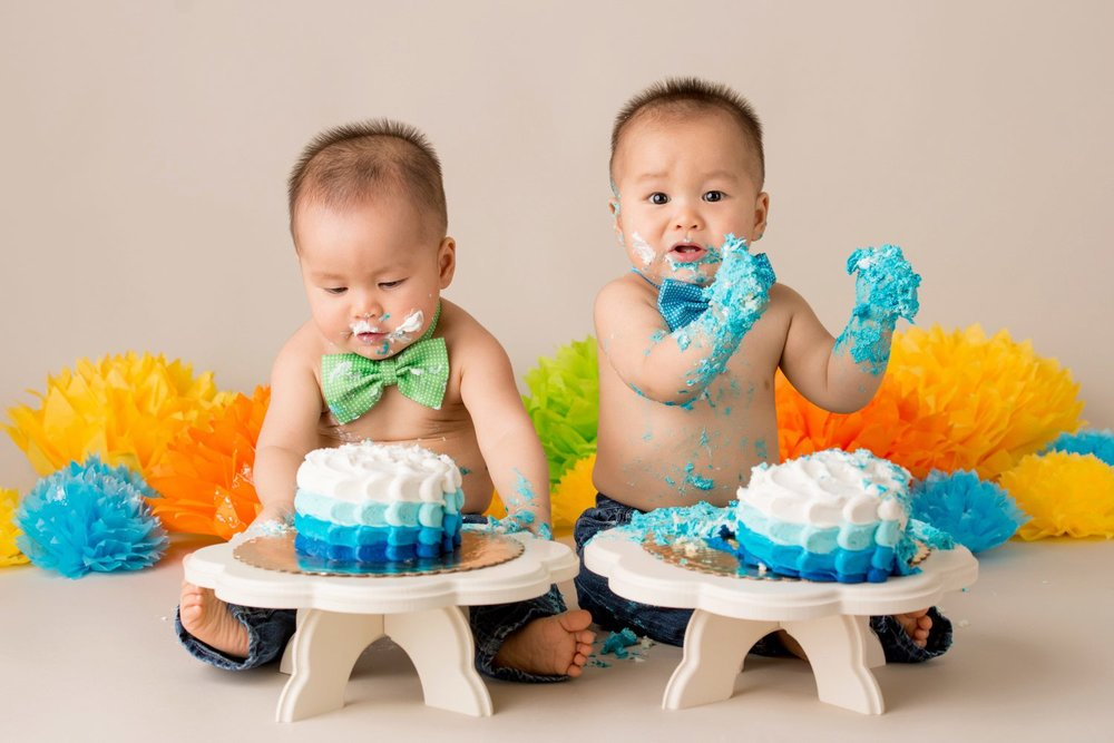 colorful cake smash with identical twin boys and bow ties