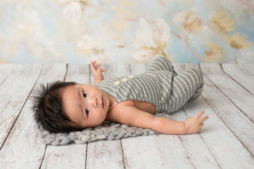 4 month old asian boy in grey