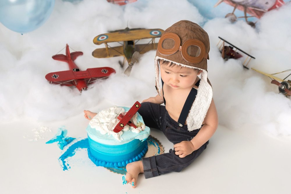 overhead shot aviator themed cake smash