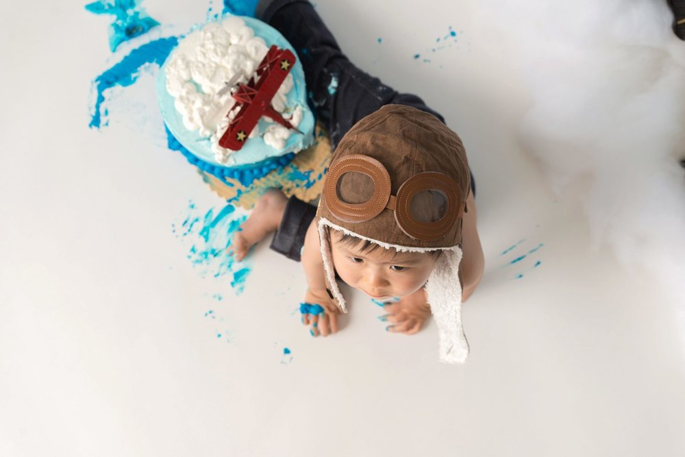 bird's eye view cake smash aviator hat