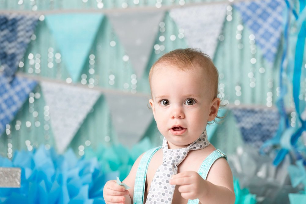birthday baby wearing tie under the sea