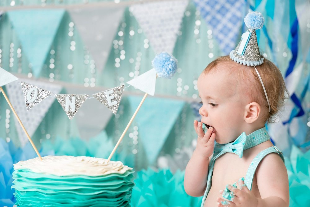 baby eating cake with his hand first smash