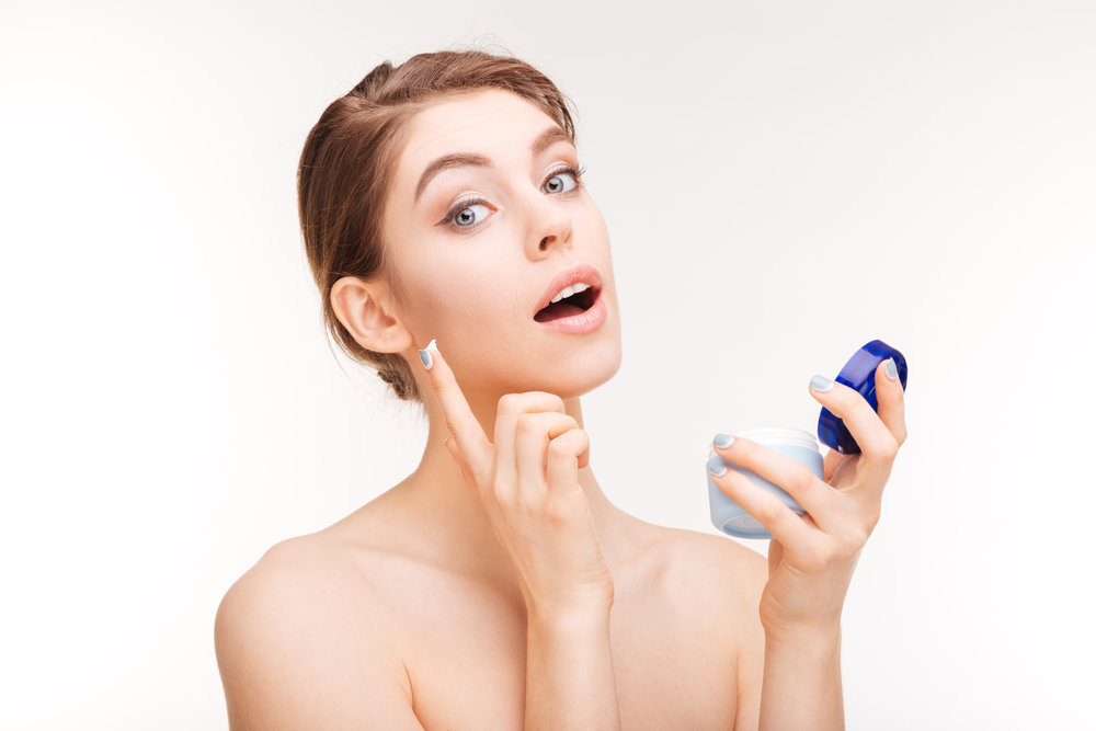 woman-applying-face-cream