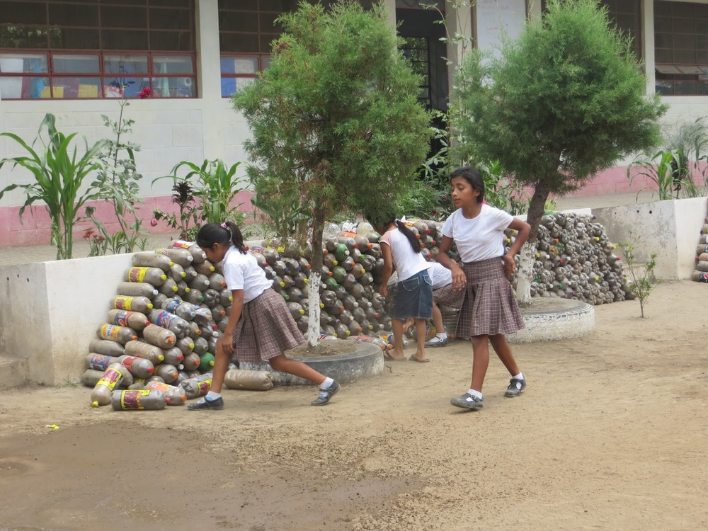 Collecting and using recycling material to create a wall at school